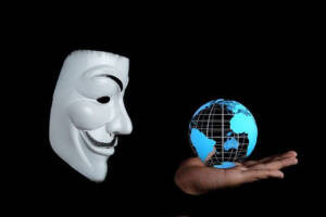 Anonymous hacker organization logo mask, world cybersecurity hacking protection