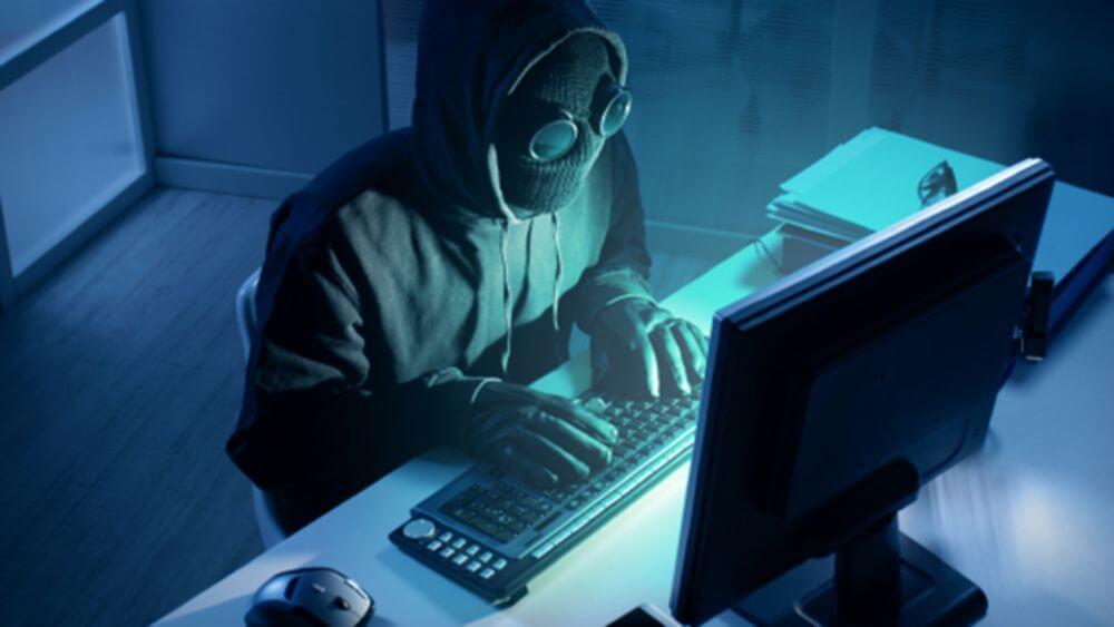 hacker on computer in the dark