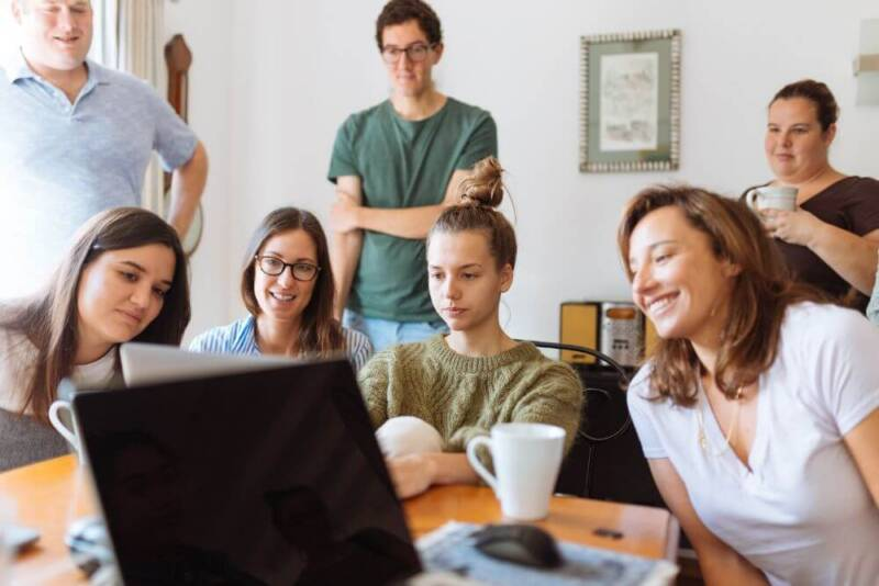 People looking at laptop working at office business VPN